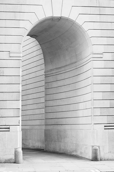 An elegant archway at one corner of the Bank of England in London.