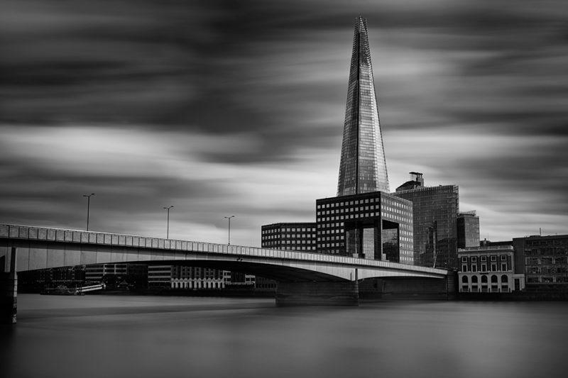 Black and white photo of the Shard and London Bridge