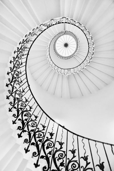 Black and white photograph of the Tulip Stairs in the Queen's House, Greenwich